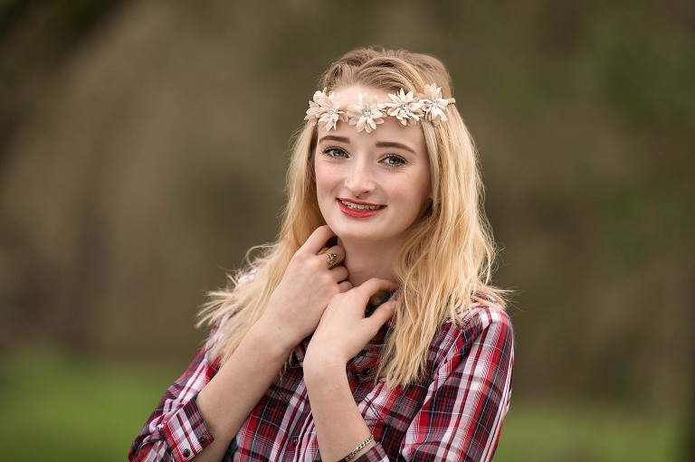 high school senior girl with flower headband